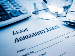 Lease agreement form on a desk.